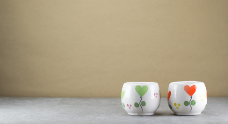 same: Small same cups  on loft style table. Stock Photo