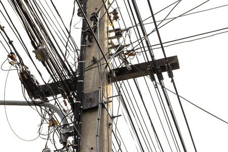 wire mess: many electrical wires on poles isolated on white.