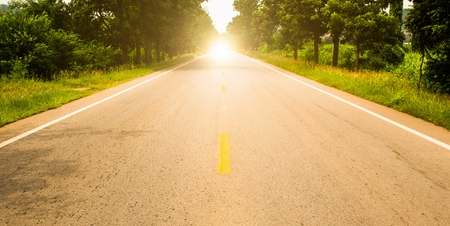 Road ahead and the sunrise for travel 写真素材
