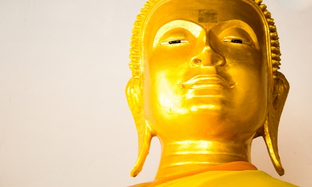 buddha face: Golden Buddha face in candlelight Stock Photo