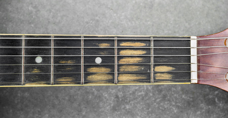 fingerboard: Old Fingerboard of guitar from heavy use
