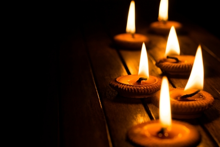 peace concept: candle light on wood plate