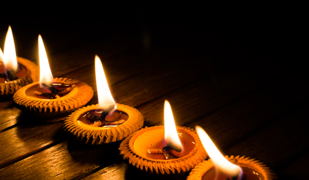 candle light on wood plate