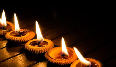 meditation symbol: candle light on wood plate