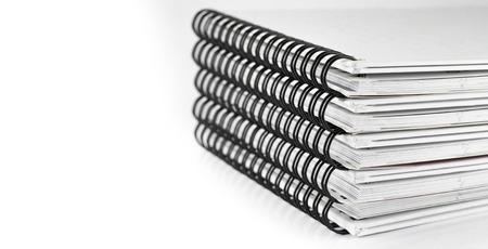 ridge coil of calendar pile on white isolate Stock Photo