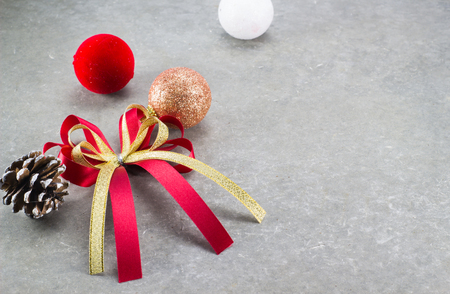 Red and gold bow of ribbon on cement background for fill text in space