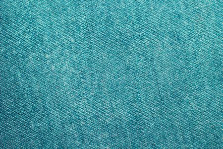Texture of green jeans background Standard-Bild