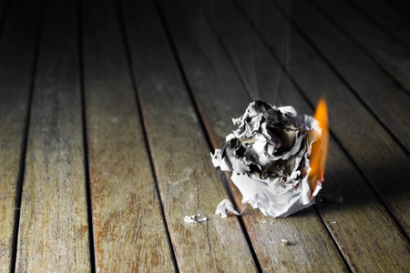 waste paper: waste paper burn on wooden table Stock Photo
