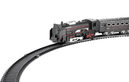 black train: Toy train isolated on white background for fill text in space Stock Photo