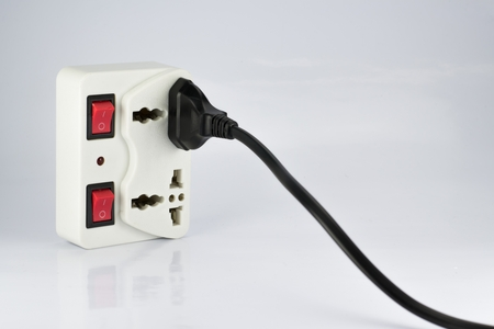 switch plug: plug socket with switch onoff and plugs on white background