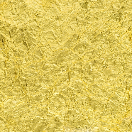 crinkled: texture of golden sheet rumpled for background Stock Photo