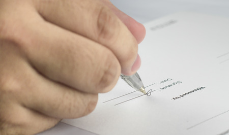 stipulation: Signing the contract in business work for mutual benefit. Stock Photo