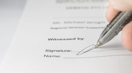 pact: Signing the contract in business work for mutual benefit. Stock Photo