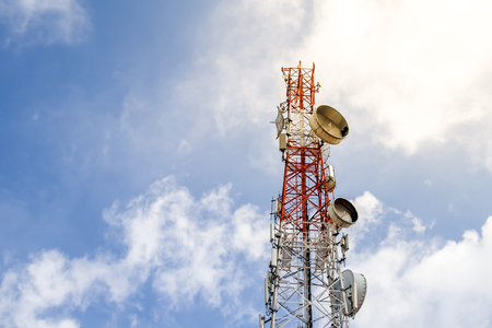 Antenna tower for communications in blue sky background.