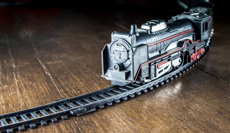 Toy train on wood background for fill text in space