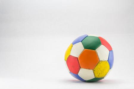Colorful dirty football on white background. Zdjęcie Seryjne