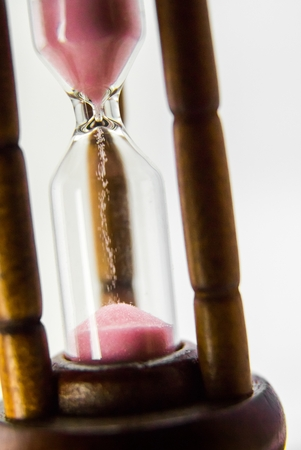 Hourglass on white background. The concept of time