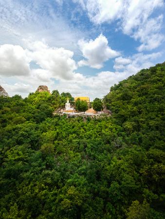 Buddha statue on mountain in Kanchanaburi, Thailand. Zdjęcie Seryjne