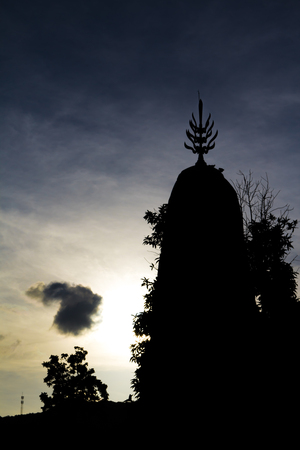 Silhouette of the Prang of Wat Mano thammaram (Wat Nang no) is located in Tha Muang District. KanchanaBuri, Thailand. Is a historical site in Ayutthaya period.