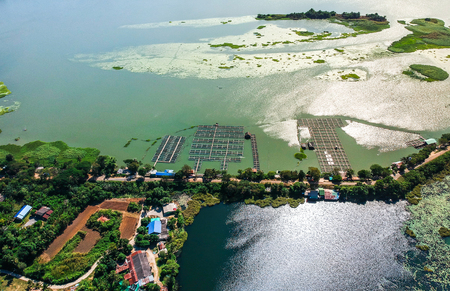 Aerial photos lansdcape of fish farmers' cages in the lake.