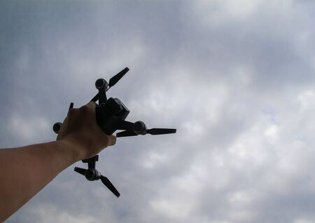 Hand take small drone. 写真素材