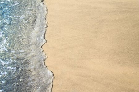 Texture of sands and sea on the beach for background.