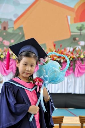 graduated: Happy girl graduated kindergarten