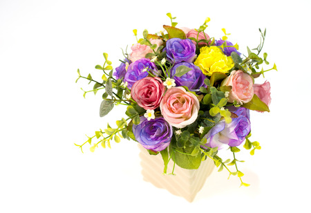 Colorful roses in a vase on white background and with clipping path photo