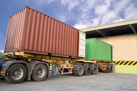 Trailers parking at warehouse to load products photo