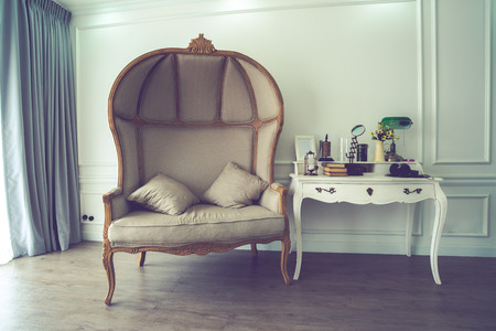 untidy: Vintage of brown sofa and untidy desk