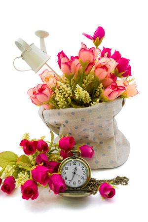 Roses in fabric sack with pocket watch aside as timeless love concept photo