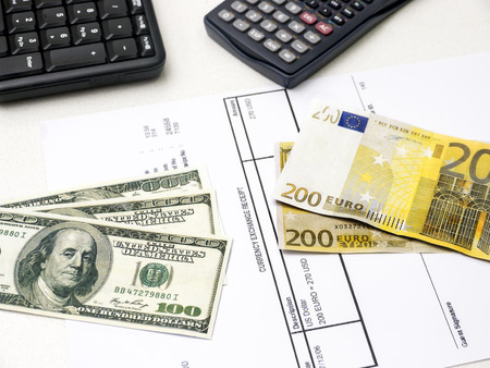 household money: Euro bill exchange for US dollar bills Stock Photo