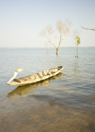Fishing boat at big lake on the mountain photo