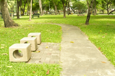 Cement chair in the peaceful park photo