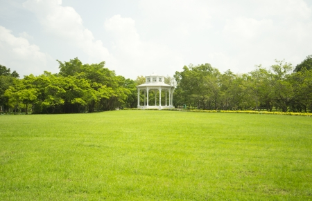 Pavilion in the park with green grass photo
