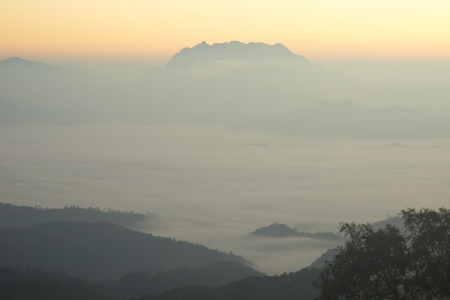 sun rise over a fog and mountain Stock Photo - 17012162