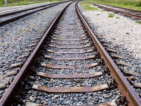 Long empty railroad tracks go into the distance, travel concept Imagens