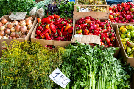 Farmers food market with fresh, varied, seasonal, organic vegetables and fruits. Bio food for healthy life. Farm vegetables and greenery in the box.