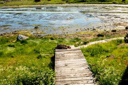 Old wooden footpath in village Teriberka, Kola Peninsula, Kolsky District of Murmansk Oblast, Russia