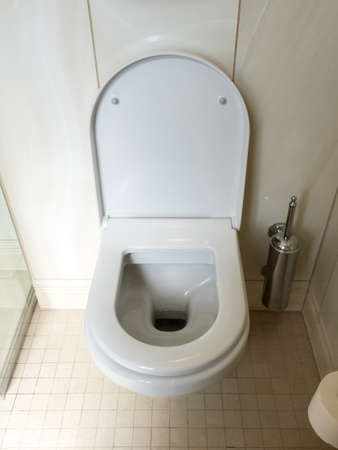 Close-up image of toilet bowl, white toilet in the bathroom.