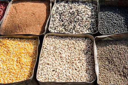 Organic dried beans, corn, mung bean, chickpeas on the farmers market. Healthy vegetarian food.