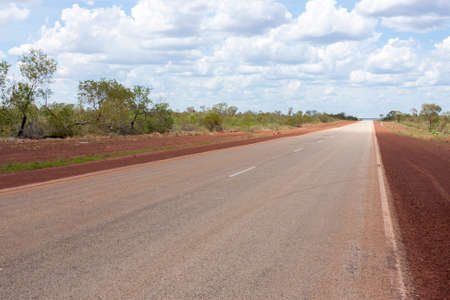 Empty asphalt road through Australian outback. Central Australia