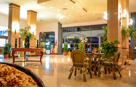 Hurghada, Egypt - May 15th, 2018: Interior view of the hotel lobby in Egypt, Hurghada. Places for recreation tourists. Tables and chairs.