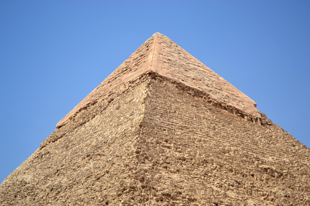 Photo of the top of the pyramid of Khafre against the blue sky. Closee view. Remains of ancient veneer. Stock Photo