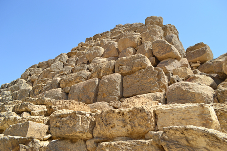Bottom view of the ancient stones of the great pyramid in Giza. Close view of the pyramid detail.