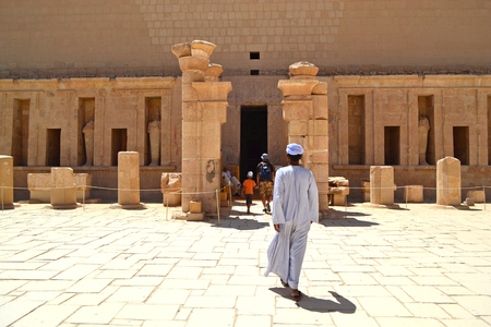 Entrance to the Hatrepsut Temple in Luxor. A man Arab comes to the temple after the tourists. Pharaoh s memorial temple in Upper Egypt on the west bank of the Nile.