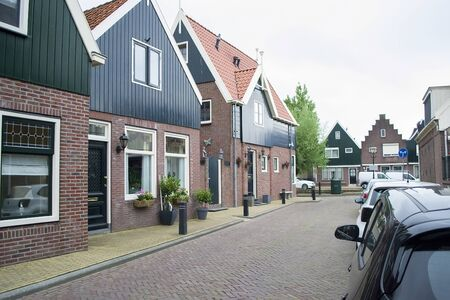 Views of the famous Dutch province - a medieval fishing town - Volendam. Now - a residential village and a famous tourist attraction.Dutch village architecture. Stockfoto