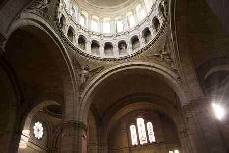 Paris, France - 6th June, 2019: Interior of the Sacre Coeur Basilica with pretty amazing stained glass windows and beautiful dome.