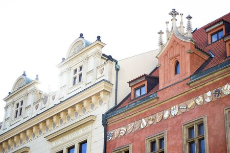 Amazing architecture of the Old Town part of the Prague. Details and elements of architectural decorations on the facades and roofs of the houses.