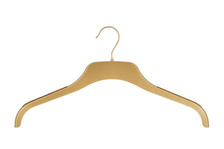 Gold colored clothes hanger isolated on a white background Stock Photo